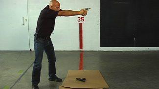 SWAT 015058f_U3021U_c Transitioning to Backup Gun