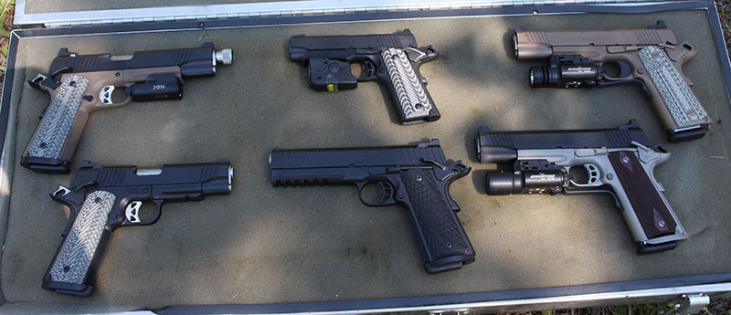 Pistols used in evaluation, left to right, top row: Roberts Defense with SureFire XC1, Browning Black Label with Streamlight TLR-6, Colt M45A1 with SureFire X300. Bottom row: Roberts Defense 9mm, STI 9mm, Colt Rail Gun with SureFire X200.