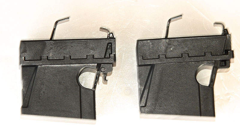 Ruger mag well on left, Glock mag well on right. Visible hook on Ruger mag well enables SR series magazines, which unlatch from the front rather than the side, to be used