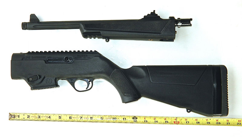 When taken down, Ruger PC Carbine is less than two feet long. Here, charging handle has been moved to left side.