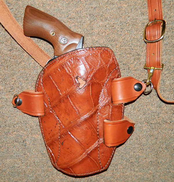 "Rob Leahy's personal Sourdough Pancake holster is constructed of alligator and attached to Simply Rugged's optional Chesty Puller chest harness. ""Flaw"" in center of holster is actually a tooth mark from a fight with another gator."