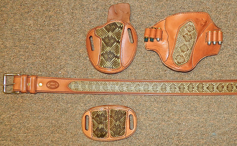 Cuda holster for 1911 with CID magazine pouch and lined 1¾-inch gunbelt and Texas Pancake (top right) for large-frame revolver. Snake skin is from a Mojave rattlesnake—a former resident of Gunsite.