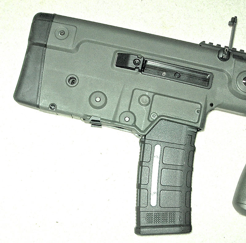 X95 is butt heavy. Right-side ejection port is open, 30-round PMAG with witness panel inserted deep into receiver, and rear flip-up BUIS is engaged.