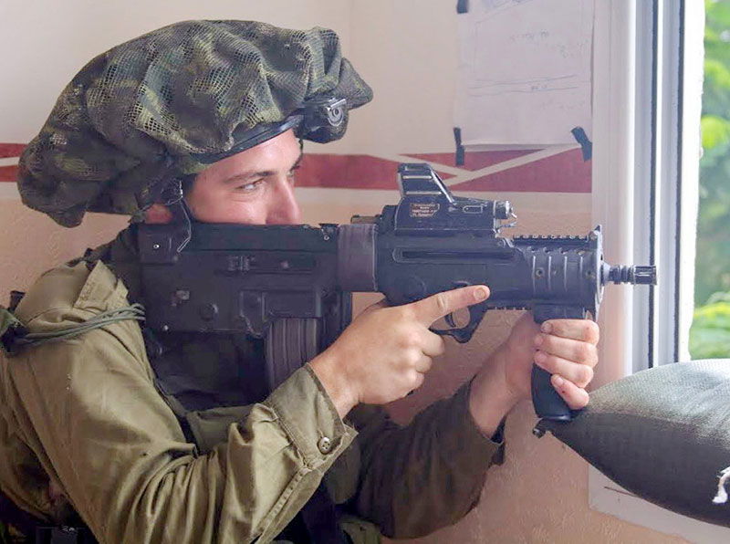 Micro Tavor X95 with 13-inch barrel and some type of electro-optical sight is favored by many IDF soldiers. This X95 is equipped with traditional trigger guard.