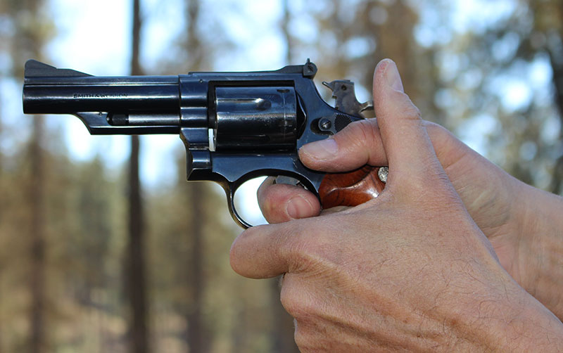"When shooting double-action, author prefers the finger be placed in the ""power crease."""