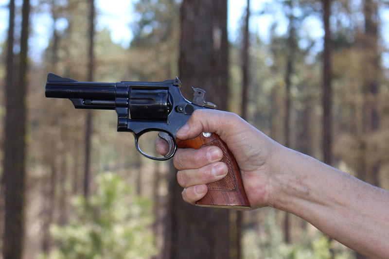 When shooting single-action, the pad of the finger is on the trigger.