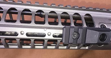 Threaded holes in handguard accept accessory rails, such as QD sling mount rail shown here.