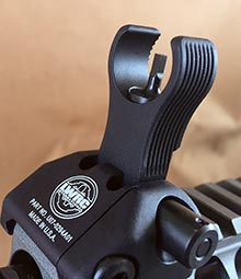 Front sight is adjustable for elevation and has a partial hood to protect front-sight post and reduce glare.