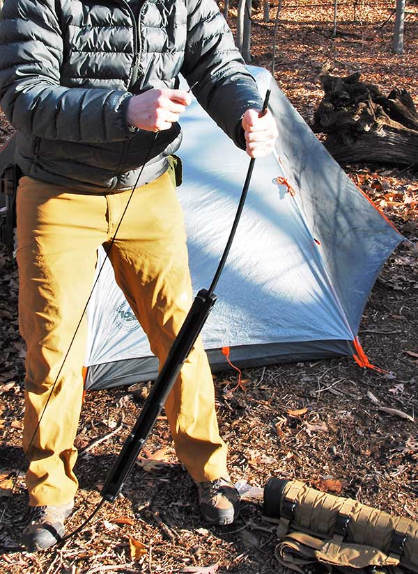 Author demonstrates how a foot on the bottom limb allows the bow to be quickly strung for use or unstrung for storage.