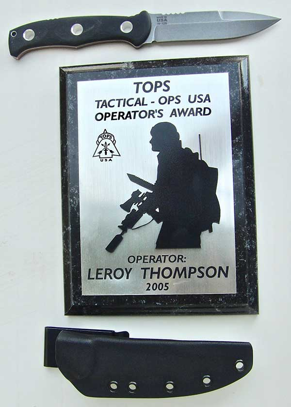 TOPS Knives has always encouraged military and law enforcement personnel, including awards for operators. Mini SERE Operator with one of TOPS' awards.
