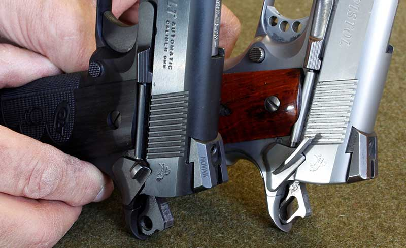 Standard small safety on the left, compared to a slightly extended model on Gunsite pistol.