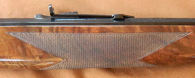 Forend and pistol grip area on Model 1892 are checkered for a sure grip as well as aesthetics.