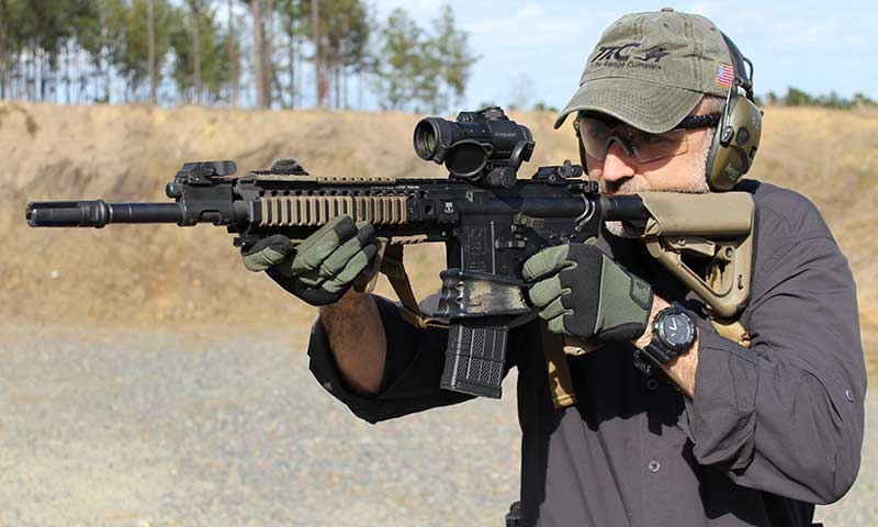 Technology needed to improve the M4/M4A1 series of carbines is already in use. Although it's a piston gun, author's AR has all the upgrades he recommends: mid-length gas system, better flash hider, grip, and Melonite-treated barrel, firing pin, bolt, and bolt carrier.