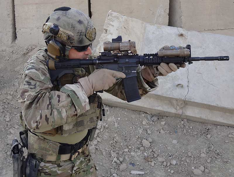 Author using general-issue M4 equipped with then-current SOPMOD Block II items in 2015. Except for a heavier barrel, the carbine itself has remained almost unchanged since its first issue in the late 1990s.