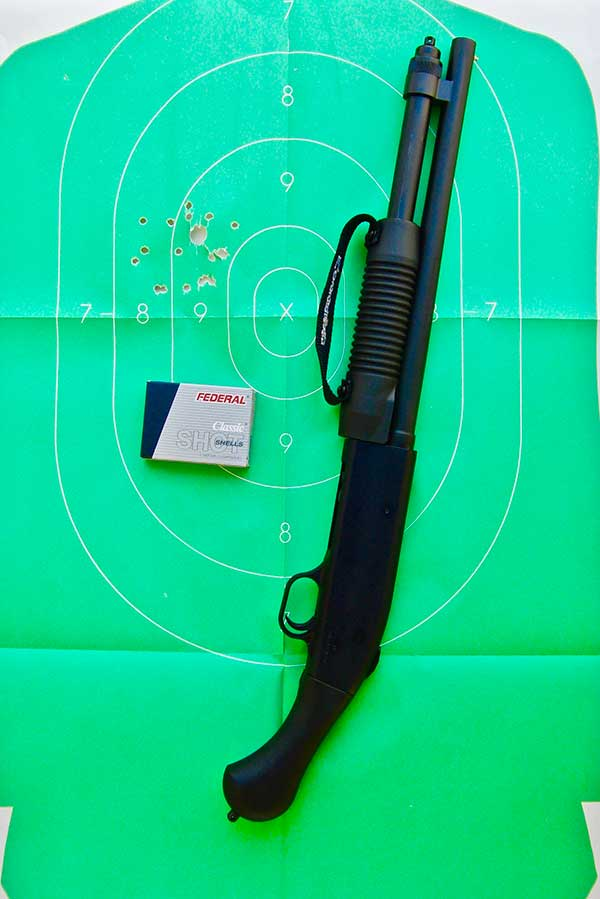Firing Mossberg Shockwave 20-gauge from the hip takes some practice to determine where to hold, but it patterns well with Federal Classic #3 Buckshot at ten yards.