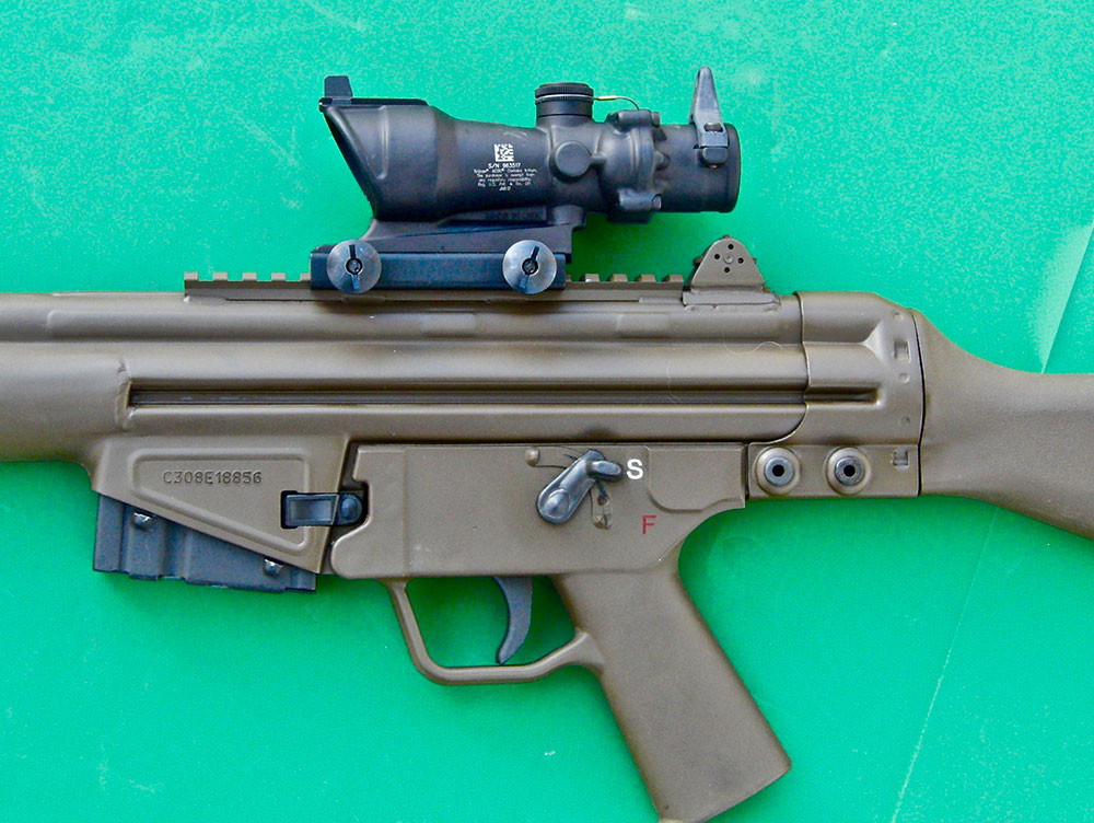 Close-up of TA01NSN-308 mounted. Flip-up sights come standard on C308. Five-round magazine in place ships with C308. In states where legal, two 20-round G3 magazines also come with the rifle.