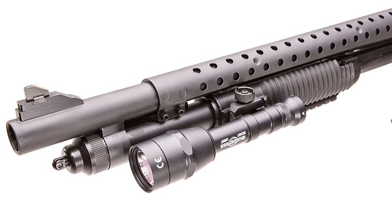 Author mounted SureFire M6001B Mini Scout Light on left forend rail.