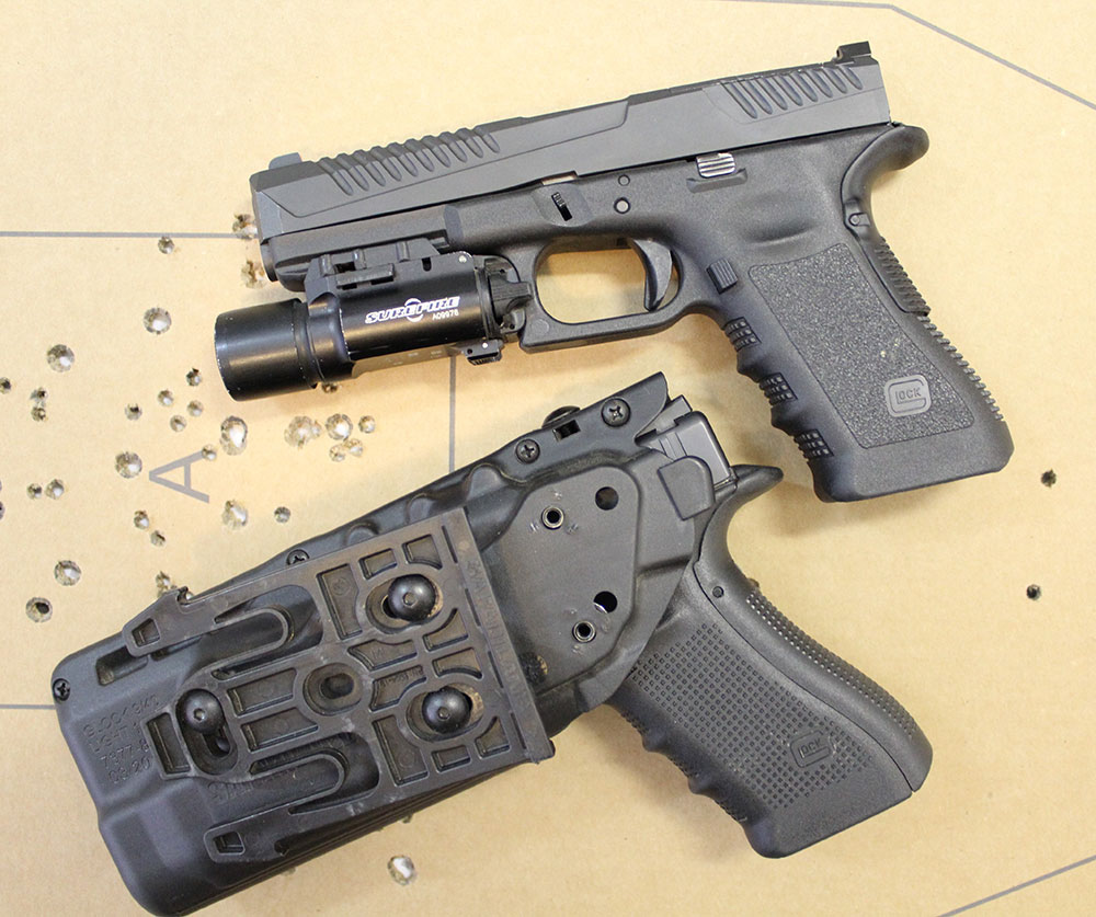 If shooters can be trained to manipulate small levers and buttons such as the magazine release, trigger, and holster retention devices like the thumb lever on this Safariland ALS holster, why is pressing the slide release viewed as an impossible task to do under pressure?