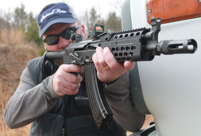Ability to mount Trijicon RMR or other forward-mounted optic shows flexibility offered by Krebs Custom PD-18 modifications.