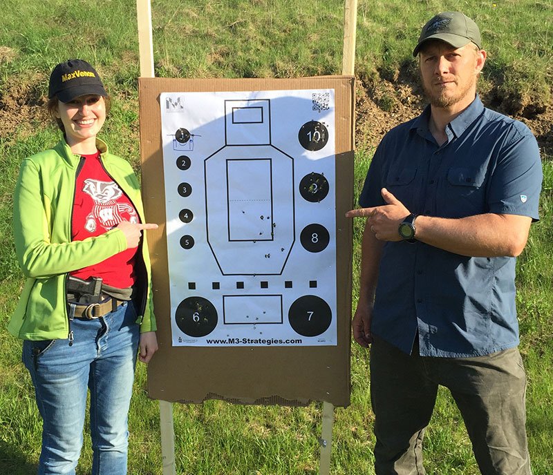 Author shows off her target with lead instructor Bill Rapier.