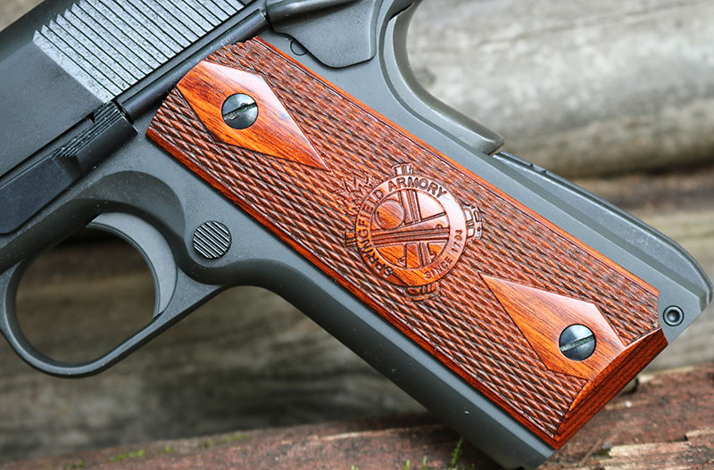 Springfield Armory 1911 Mil-Spec comes with attractive wooden grips. Dabbs' gun also included spare conservative black plastic grips.