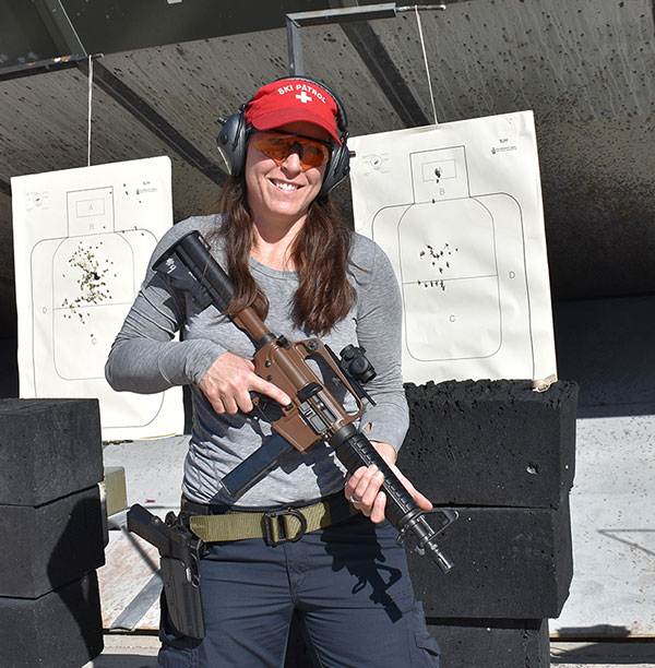 Smile is because of how well she shot—head shots were done in failure-to-stop drills.