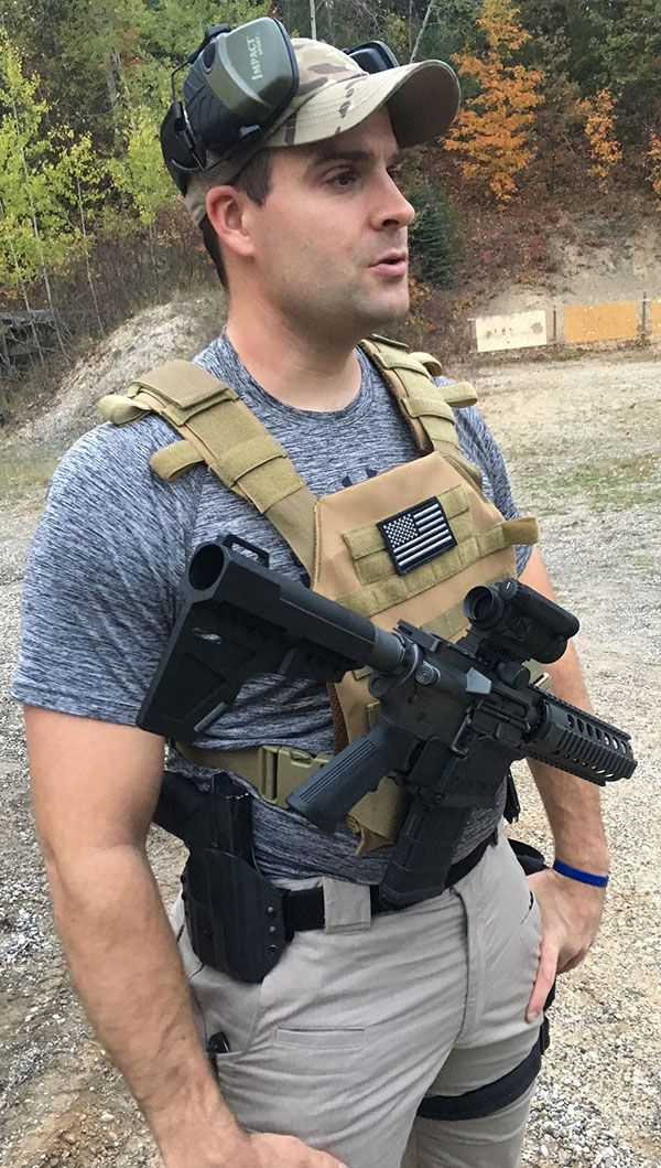 JX Tactical rifle holster fastens into MOLLE loops and releases carbine with push of a button, like a retention holster for a pistol.