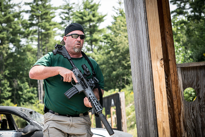 On the move to get into position to engage next set of targets at SIG Sauer Academy's Hogan's Alley range.