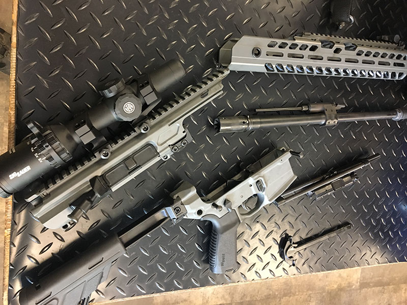 SIG MCX Virtus disassembled during barrel change procedure. Thousands of engineering hours were spent designing MCX's ability to switch calibers/barrels without impacting reliability or accuracy. Two key elements of this were gas-port location and barrel interface with receiver.