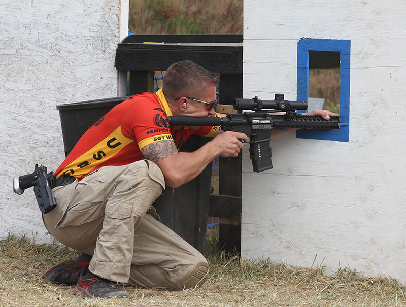 USMC Combat Shooting Team Marine maximizes points of contact while locking rifle into a corner of this shooting port, enabling rapid, precise hits at distance.