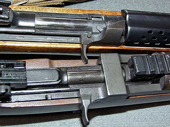 Chiappa M1-9 (bottom) lacks bolt hold open found on the original, which also utilizes a rotating bolt, while M1-9 is straight blowback.