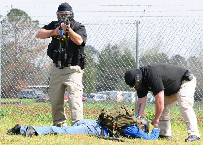 "Members of Coffee County (Alabama) Sheriff's Department apprehend ""suspect"" during active-shooter exercise conducted at Lucas Stagefield. In active-shooter or terrorist event, EMS won't render aid until scene has been secured. Photo: U.S. Army by Nathan Pfau"