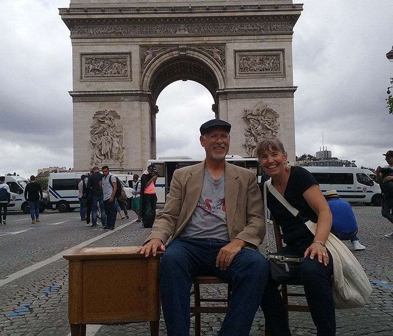 Geez, tourist! Sitting down to have your picture made at the Arc de Triomphe. Champs-Élysées is often closed to traffic, but not always.