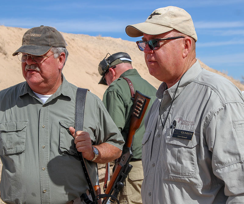 Rangemaster Lew Gosnell (right) talks to student and fellow Gunsite instructor Mario Marchman.