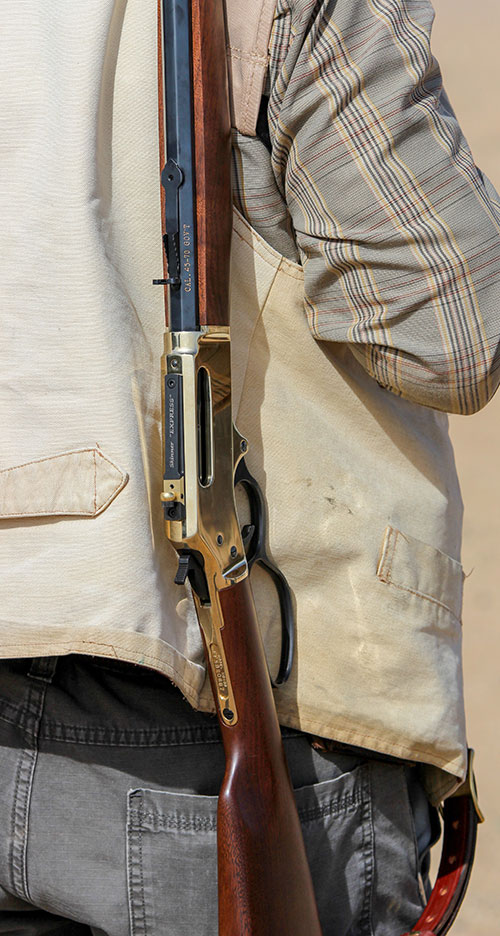 Beautiful Henry lever action rests on student's shoulder at The Craft of the Lever Gun symposium.