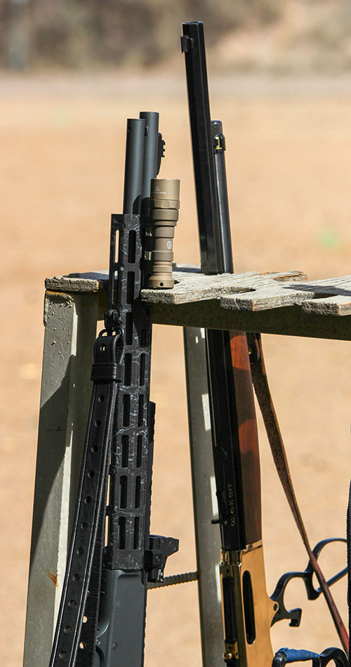 Fully tricked-out modern defensive lever-action rifle sits next to its more traditional counterpart.