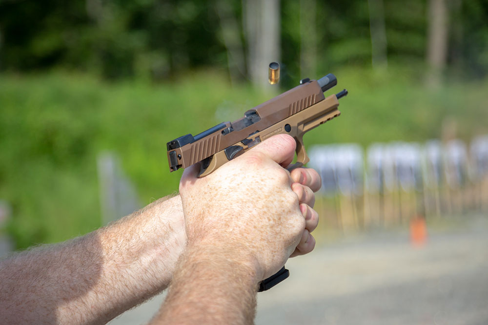 SIG P320-M17's striker-fired design is conducive to rapid controlled fire, with empty case in the air exhibiting minimal muzzle flip.