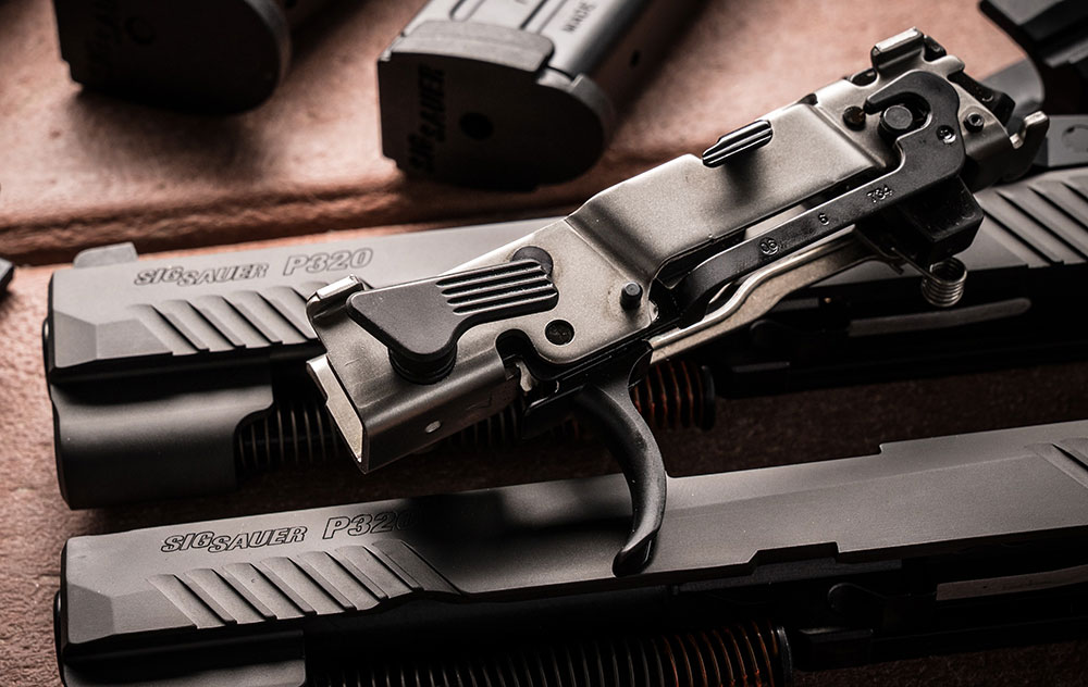 SIG Sauer P320's fire-control chassis houses ambidextrous slide catch lever, trigger bar, trigger, hammer, slide rails, and associated springs. Chassis allows for modularity of design and is serialized number component of the design.