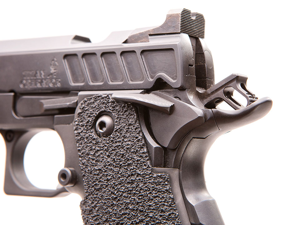 Slotted hammer reduces lock time. Step at front of rear sight enables one-handed malfunction/reload drills.
