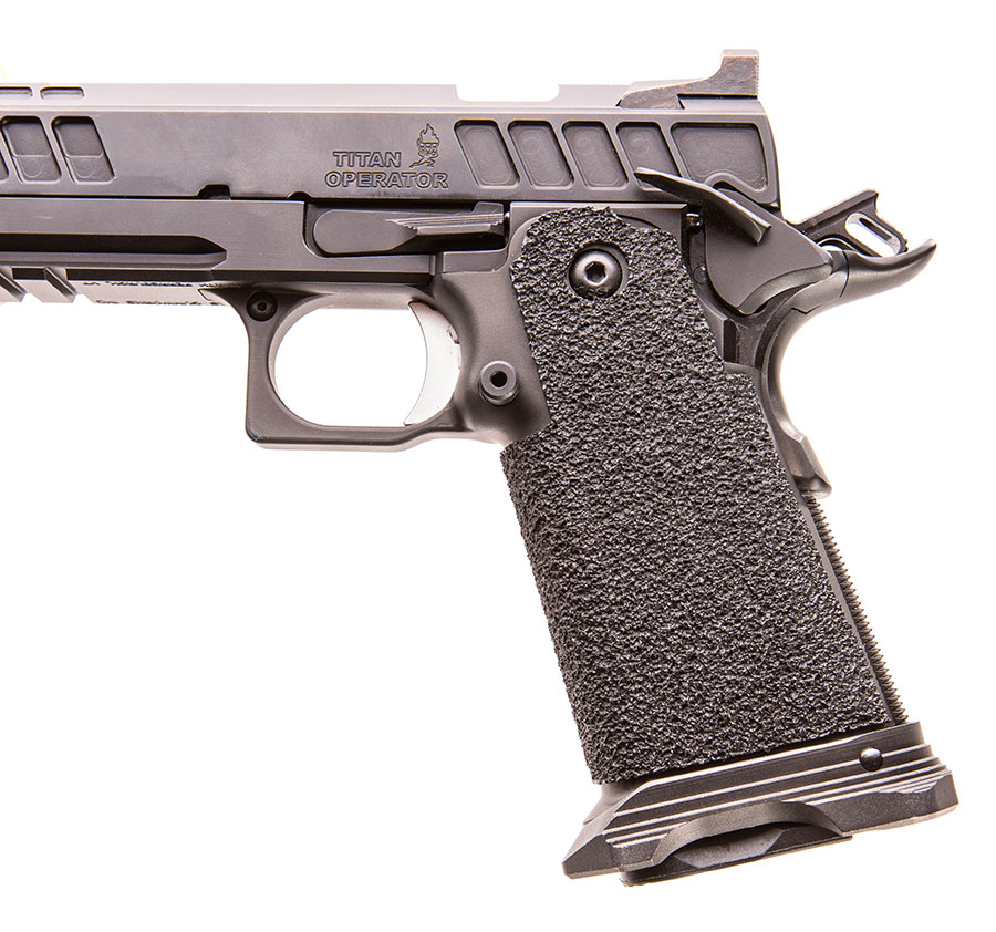 Safety, slide lock lever, and mag release are in the usual locations as found on a 1911.