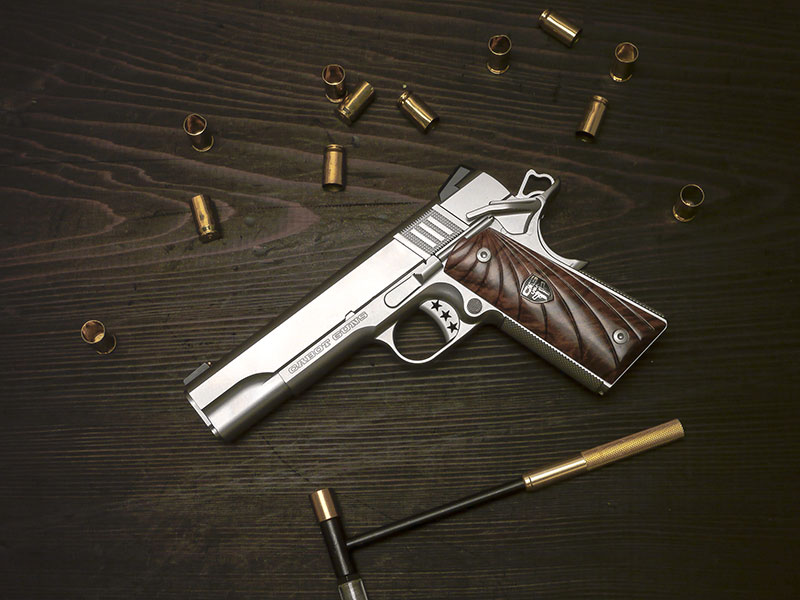 "Cabot's ""entry level"" 1911. Completely crafted of billet forged stainless steel, pistol sports exotic walnut scalloped Fibonacci grip panels. Magazine release is slightly oversized. Star trigger is fully adjustable for overtravel."