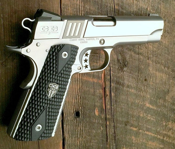 Cabot Guns S100 with G-10 Tactile grips. Virtually entire gun is crafted from billet stainless steel. Most components are made in-house. Gun has Cabot's proprietary Trinity Stripes grip serrations.