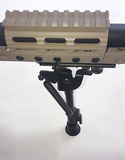 UNS (night vision) is mounted forward on the barrel. Slots are M-LOK compatible.