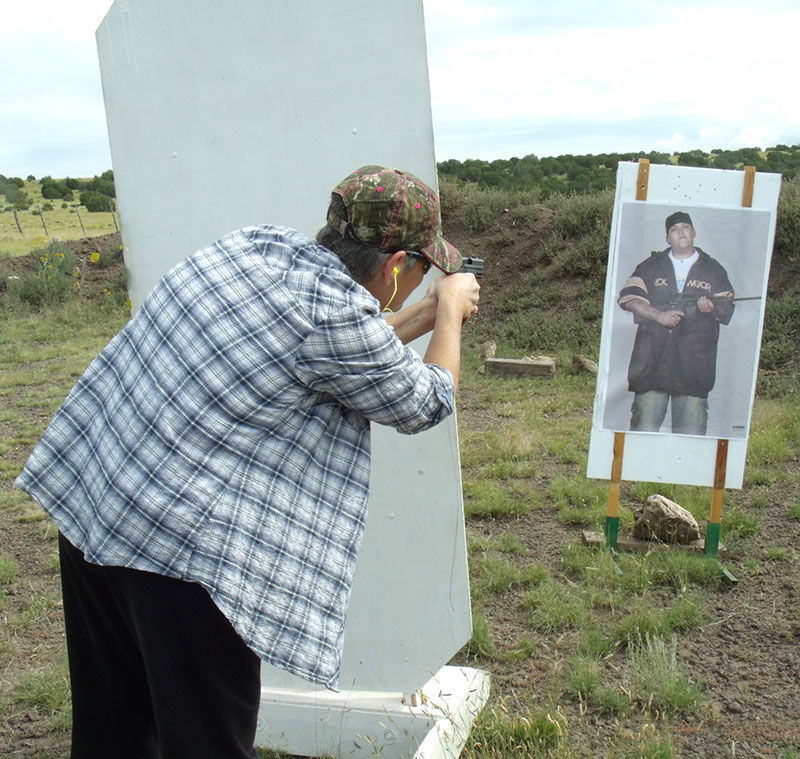 Student practices firing from around a barricade to lessen exposure to unknown assailant, a necessary element depending on the amount of cover and concealment available.