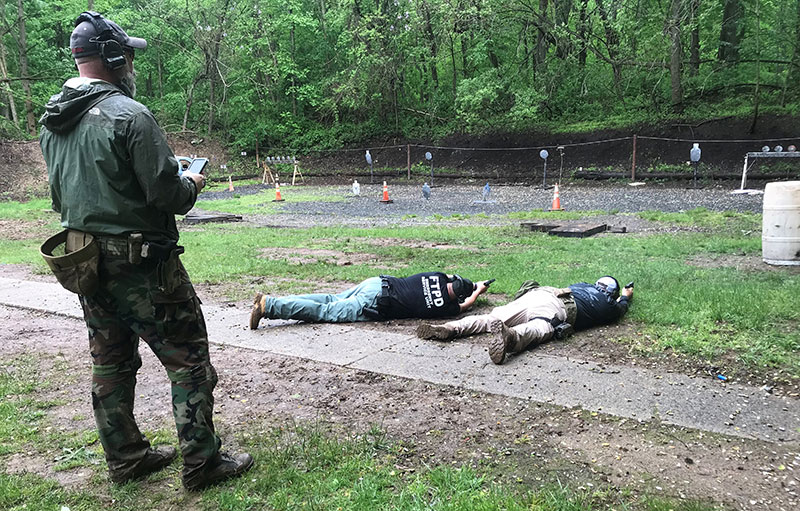Instructor coached importance of various prone handgun shooting techniques.