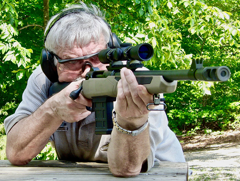 Thompson shoots from standing rest at 100 yards.