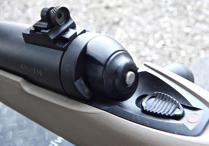 Peep back-up rear sight and sliding safety.