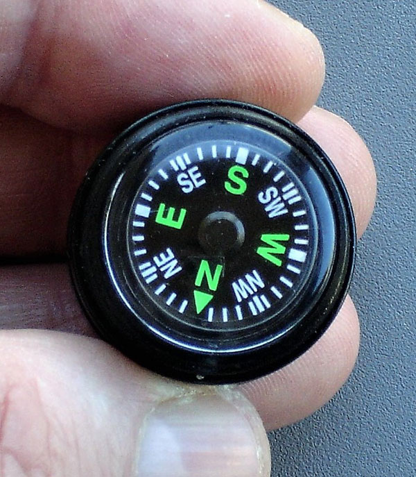 20mm Grade A button compass in cap of ESEE Fire Kit has luminous dial with large, easy-to-read markings.