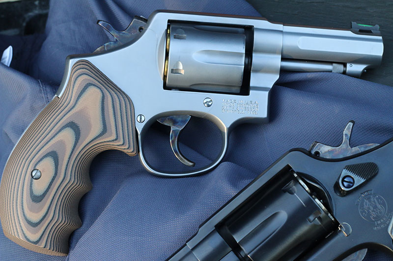 Satin finish of each gun was set off by extraordinary case hardening and polished (stainless) and nitre blue (blued) screws and coordinating G10 grips.