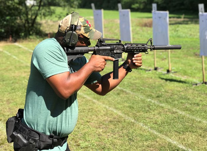 Lt. Reggie Jackson fires Colt SMG with GSL Scorpion suppressor.